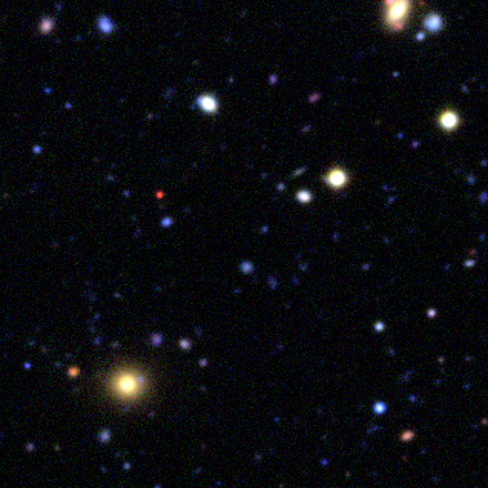 red extensions around yellow  galaxy