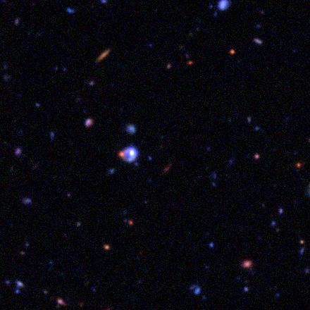 unlensed quasar, with an arc?